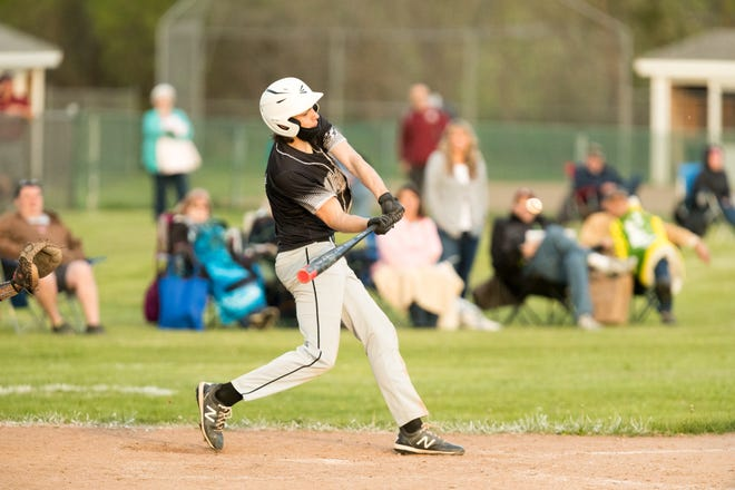 Jasper-Troupsburg's Colby Cornish lines up and delivers the game-winning hit on Friday evening in Jasper.