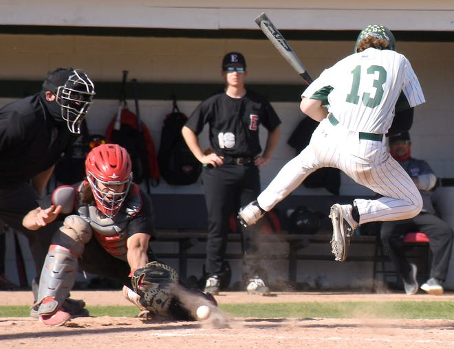 Herkimer College General Dakota Britt (13) jumps in an attempt to avoid an inside pitch against Erie Community College during the ninth inning of the Region III Final Four opener at Veterans Memorial Park Friday.
