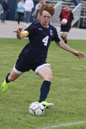 Notre Dame-West Burlington High School's Sam Brueck (4) scores a goal during the first half of their SEISC soccer tournament against Highland High School Friday May 14, 2021 at Notre Dame's Tackelson Field.