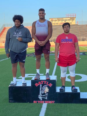 Hays High's Gaven Haselhorst, middle, was the WAC champion in the shotput.