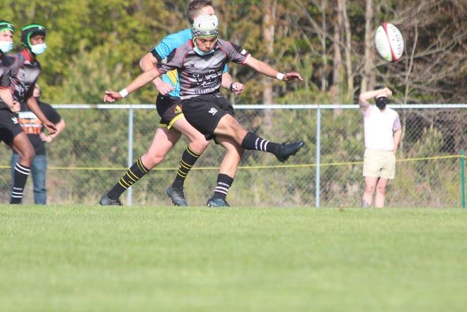 Calixto Sotelo Jr. kicks the ball during a rugby match