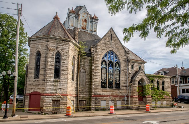 The historic Hale Memorial Church, built in 1900 at the corner of Main and High streets, is back up for sale and in danger of being demolished. Caution tape blocks the sidewalks along the crumbling building.