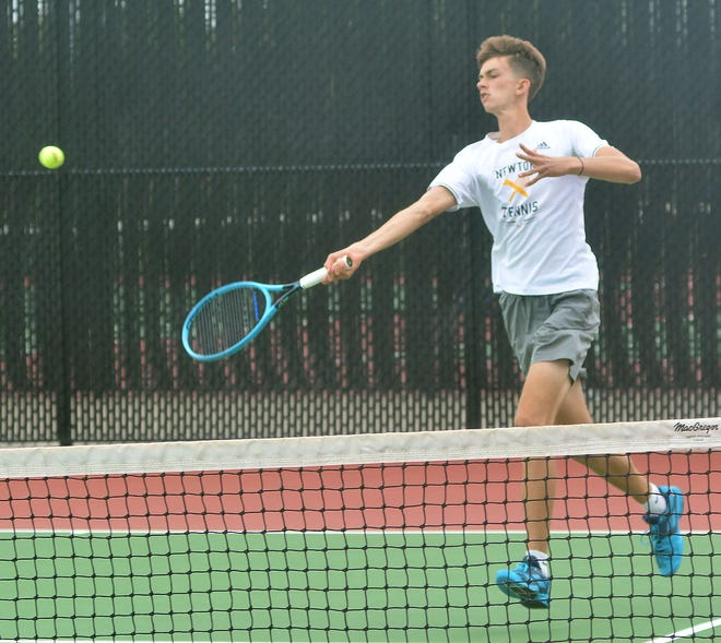 Newton senior Jonah Schloneger competes in doubles play at the Class 5A state tournament.