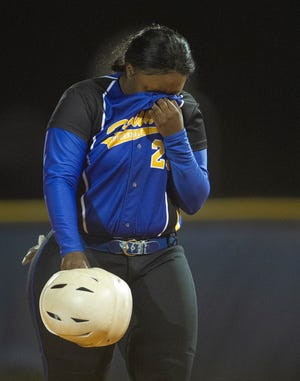 Auburndale's Johnkiria Bland reacts as she walks off the field after their loss to Bayside during the Class 5A, Region 3 final at Auburndale.