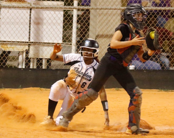 Hernando catcher Hannah Taylor comes up with the ball as Lake Region's Armani Wright looks to the ump after being thrown out at home by the shortstop with the bases loaded in the seventh inning. Hernando held on to a one run lead over the Thunder 4-3.