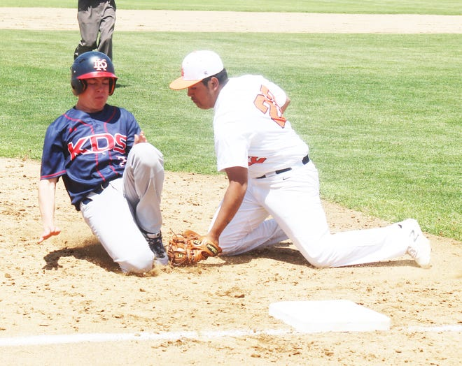 La Junta High School's Steven Salas (22) tags out Kent Denver's Joe Roode who was attempting to steal third. The Tigers lost to the Sun Devils 5-3.
