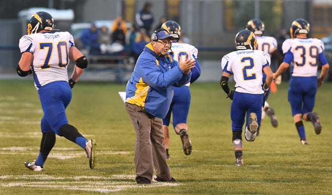 --Monroe News Photo by TOM HAWLEY Ida football coach Tom Walentowski cheers on his players after a touchdown against Dundee in 2015.