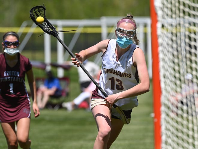 Algonquin's Lucy Rogers eyes the net as she loads up for a shot on goal during the second period against Groton-Dunstable earlier this season.