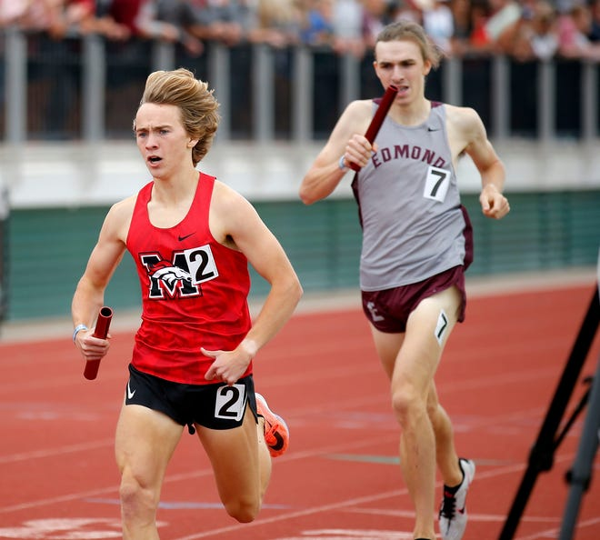 Mustang's Gabe Simonsen (2) finishes ahead of Edmond Memorial's Andrew Cordova in the 4x800 relay on Saturday at the Class 6A state meet at Edmond Santa Fe High School.