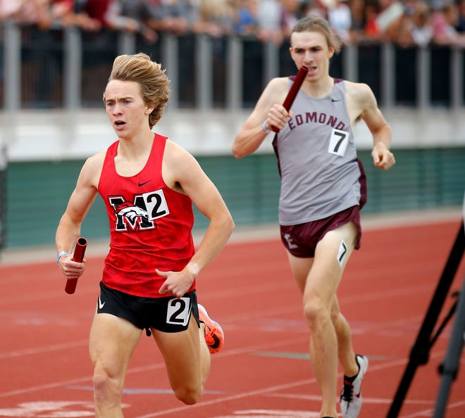 Mustang's Gabe Simonsen finishes ahead of Edmond Memorial's Andrew Cordova in the 4x800 meter relay race during the 6A track and field state championships as Edmond Santa Fe in Edmond, Okla., Saturday, May 15, 2021.