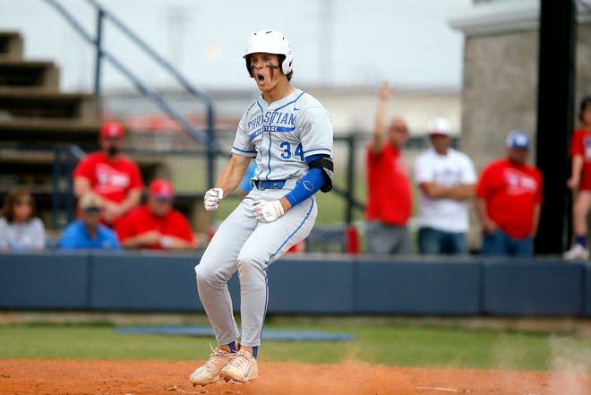 Christian Heritage Academy's Lane Behymer celebrates after hitting a home run during a Class 2A baseball state tournament championship game between Silo and Christian Heritage Academy in Shawnee, Okla., Saturday, May 15, 2021.