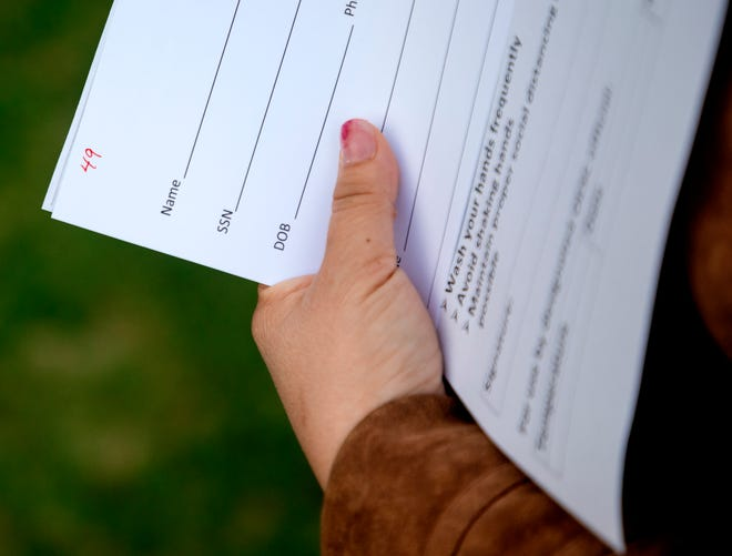 An Oklahoman holds unemployment paperwork during an event to resolve issues that prevented state residents from receiving unemployment payments in June of 2020. Conduent, a Yukon company the state contracted with to distribute unemployment benefits, recently reached a settlement to resolve a dispute over alleged discriminatory hiring at the company. [Chris Landsberger/The Oklahoman Archives]  .