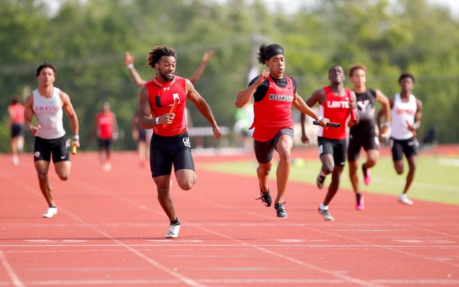 Tulsa Union's Dayan Aromaye, left, and Westmoore's Koryee Wyatt approach the finish line during the 4x100-meter relay preliminary race during the Class 6A state meet at Edmond Santa Fe on May 15.