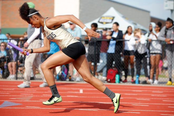 Midwest City's Grace Pendarvis begins the 4x100-meter preliminary race during the Class 6A state track meet on May 15 at Edmond Santa Fe.