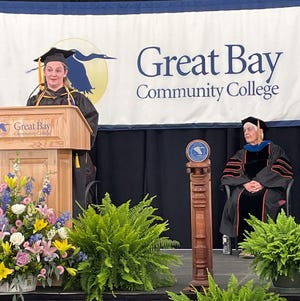 Great Bay Community College 1 p.m. Class of 2021 Student Commencement Speaker Reigan Toof gives the address while College President, Dr. Cathryn Addy looks on.