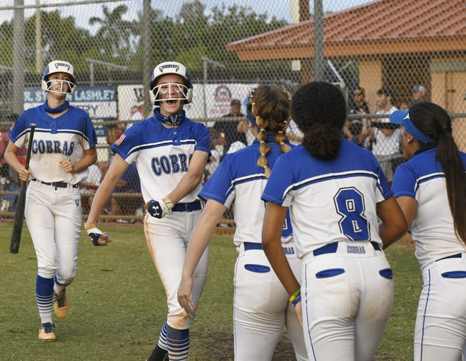 Park Vista's Emily Konz is congratulated by teammates after speeding around the bases for a run. She successfully bunted in the bottom of the second inning and scored from first base on an errant throw. Park Vista went on to win the game, 6-2.