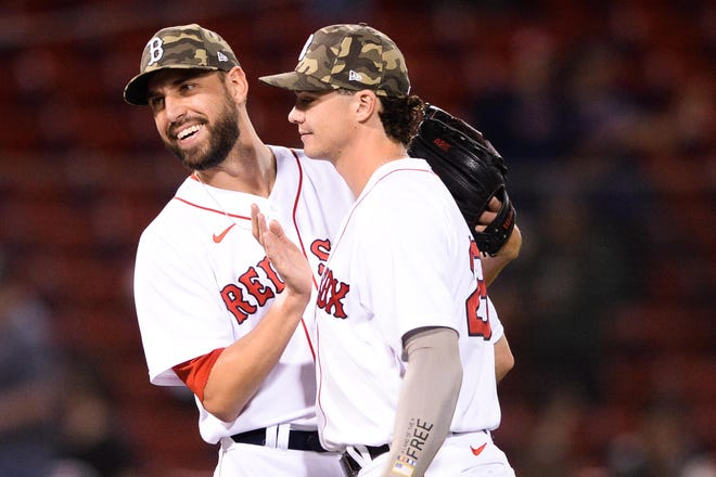 Matt Barnes (left) pats teammate Bobby Dalbec on the chest after a 4-3 win against the Los Angeles Angels at Fenway Park in Boston on May 14, 2021. Barnes has been nearly perfect for the Sox this season.