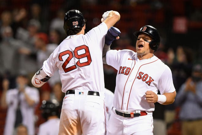 Red Sox first baseman Bobby Dalbec, left, celebrates with right fielder Hunter Renfroe after hitting a two-run home run against the Angels during the seventh inning on Friday night at Fenway Park. Renfroe also hit a two-run homer earlier in the game as Boston won, 4-3.