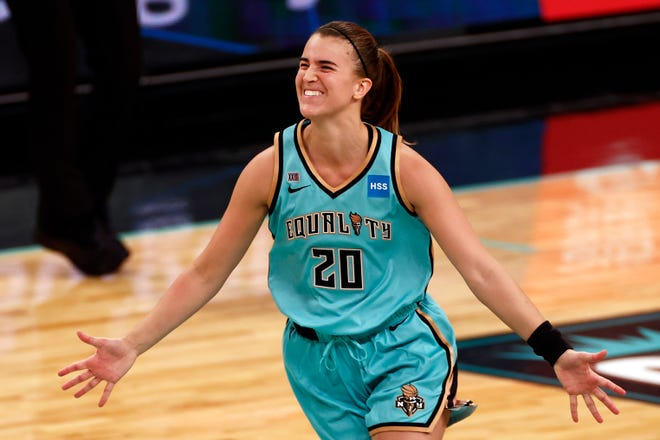 New York Liberty guard Sabrina Ionescu reacts after hitting the game-winning shot against the Indiana Fever in Friday's game in New York.