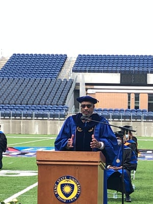 Hector C. McDaniel, president of Stark County NAACP, delivers an impassioned speech during Friday's graduation for Kent State University at Stark campus. The ceremony took place in Tom Benson Hall of Fame Stadium in Canton.