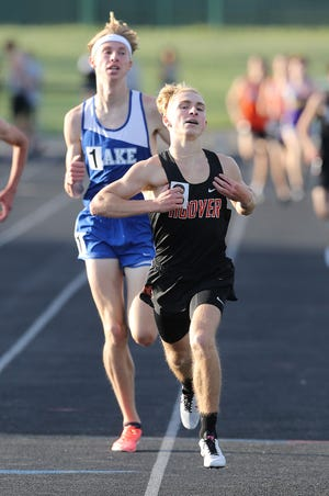 Hoover's Blaze Fichter edges out the win over Lake's Connor Wertman in the 1,600-meter run at Friday's Federal League meet.