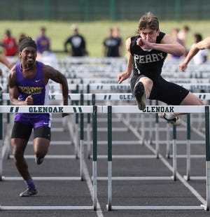 Perry's Luke Laubacher (right) battles Jackson's DJ Harris in the 110-meter hurdles at Friday's Federal League meet.