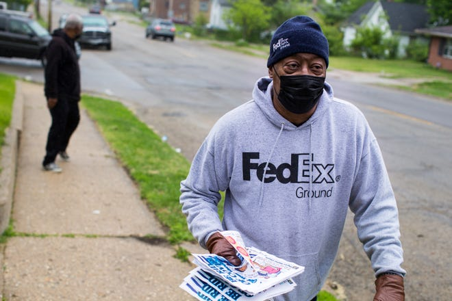 Deacon Oliver Emerson, right, of Pilgrim Baptist Church, and volunteer Dwayne Collins of Rockford walk door-to-door Saturday, May 15, 2021, along Montague Street in Rockford to inform residents of an upcoming COVID-19 vaccination clinics at the church.