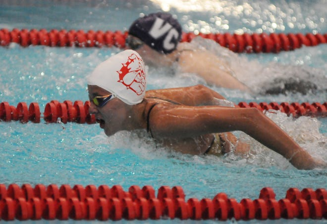 McPherson's Danica Brunk takes a breath while competing in the 200-yard individual medley in the Ark Valley Chisholm Trail League Division II-IV Championships at Salina South natatorium on Friday. Brunk finished in first place with a time of 2:16.84.