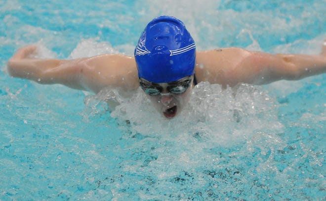Andover High School swimmer Natalie Neugent takes a breath during the 100-yard butterfly in the Ark Valley Chisholm Trail League Division II-IV Championships at Salina South Natatorium on Friday. Neugent won first place with a time of 1:01.44.