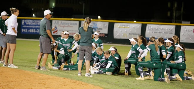 Venice High softball coach Steve Constantino speaks with his team after a season-ending 8-0 loss to Mitchell in the regional final Friday at Venice High.