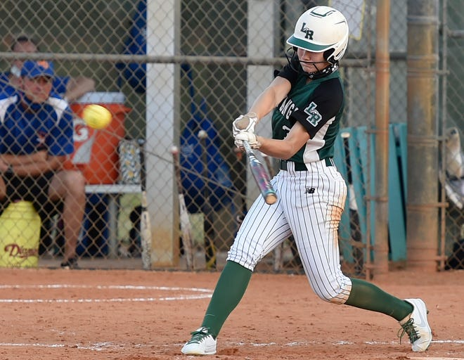 With the bases loaded Lakewood Ranch High's Cassidy McLellan belts a home run against the West Orange Warriors on Friday night at Lakewood Ranch High.