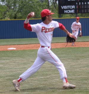 Dale third baseman Connor Kuykendall fires the ball to first base for the out Friday against Christian Heritage.