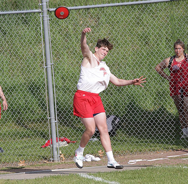 Bennett VandenBerg of Constantine competes in the discus event on Friday. He finished sixth overall in the event.