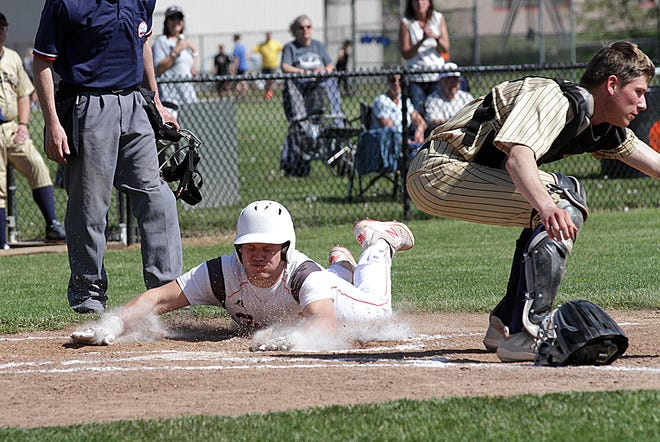 Brady Webb of Sturgis slides safely into home plate to score a run against Otsego on Friday.