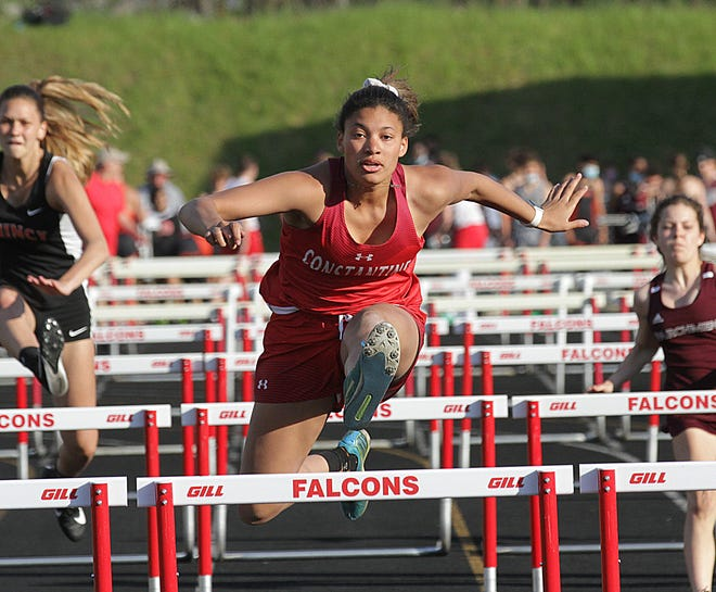 Hannah Outlaw of Constantine dominates a 100-meter hurdles race in 2021.