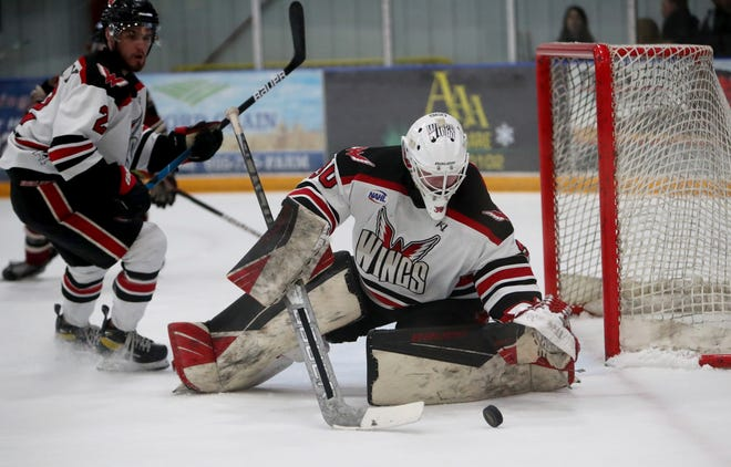 Aberdeen Wings goalie Jake Sibell stops a loose puck during the second period against the Minot Minotauros in Friday's game. American News photo by Jenna Ortiz, taken 05/14/2021.