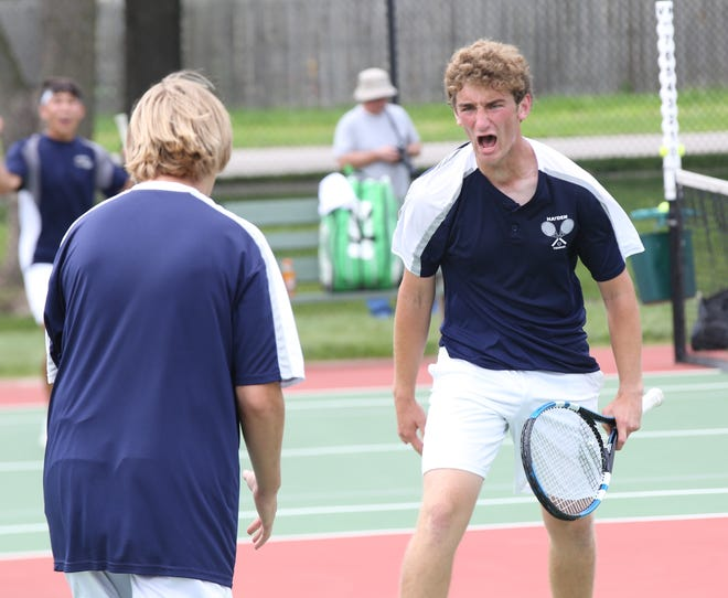 Michael Sandstrom screams in excitement after putting away a slam for match point in Saturday's Class 4A state doubles semifinals against Circle's Drew Middleton and Noah Allison. Sandstrom and partner Gus Glotzbach finished runner-up at the state tournament.