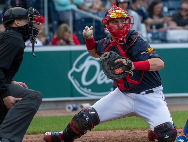 WooSox catcher Jett Bandy checks a Syracuse runner at first base during Friday's game.