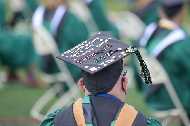 A Nichols College senior wears a decorated mortar board at Saturday's commencement.