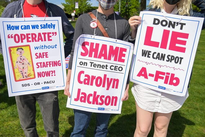 Signs worn by striking nurses at St. Vincent Hospital.