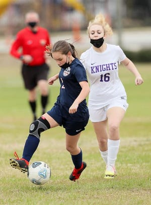 Freedom Christian's Izzie Dalton-Jimenez dribbles past a Village Christian defender during a game in the 2021 season.