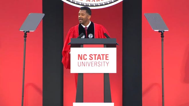 Former N.C. State quarterback Russell Wilson addressed the school's 2021 graduating class Friday in Carter-Finley Stadium.