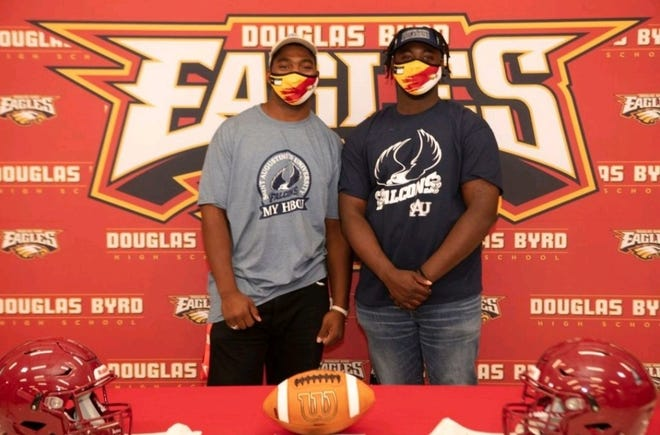 Douglas Byrd's Zyon McEachin, left, and Immanuel Wright are set to play college football at Saint Augustine's in Raleigh.