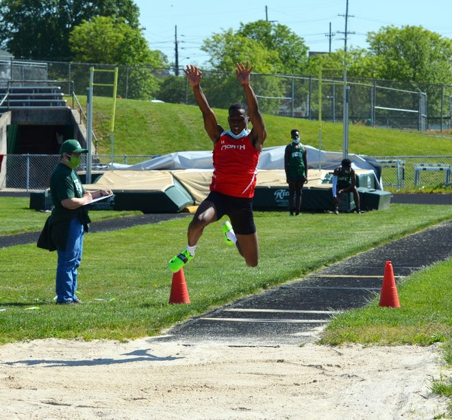 North Hagerstown senior Emi Erekosima competes in the long jump Saturday at South Hagerstown. He won that event as well as the triple jump.