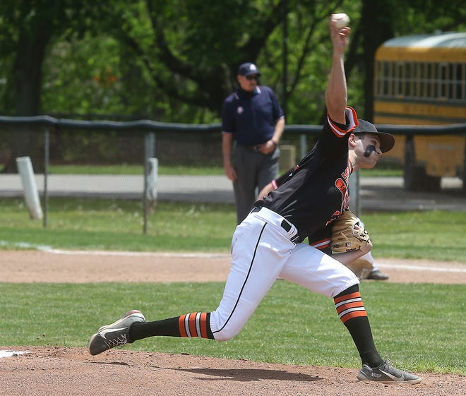 Strasburg starting pitcher Scottie Sauernheimer throws a pitch in the Division IV Sectional semifinal win over  Bridgeport Saturday.
