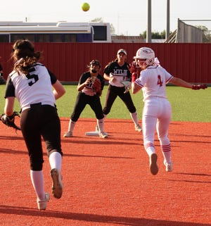 Hollyn Joachim (4) of Lubbock Monterey is caught in a rundown in the bottom of the third inning against Wylie on Friday in Hermleigh. First baseman Hanna Hood makes the throw back toward second base but Joachim reversed and made it safely back to first. She scored on Hailey Montemayor's double, as the Lady Plainsmen won 10-5. May 14 2021