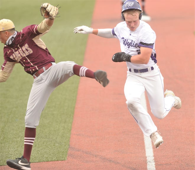 Wylie's Balin Valentine, right, sails past El Paso Andress pitcher Julius Ryan en route to scoring in the second inning. Ryan was chasing down an errant throw home, and Valentine had to throw him out of the way to score in the Region I-5A area one-game playoff Friday in Fort Stockton.