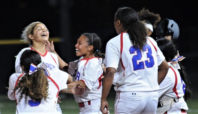 Cooper players swarm pitcher Jahlissah Marquez after she struck out Alyvia Quintana for the final out in a 9-7 victory over El Paso Hanks in Game 1 of the best-of-three Region I-5A quarterfinal playoff series Friday, May 14, 2021 in Fort Stockton.