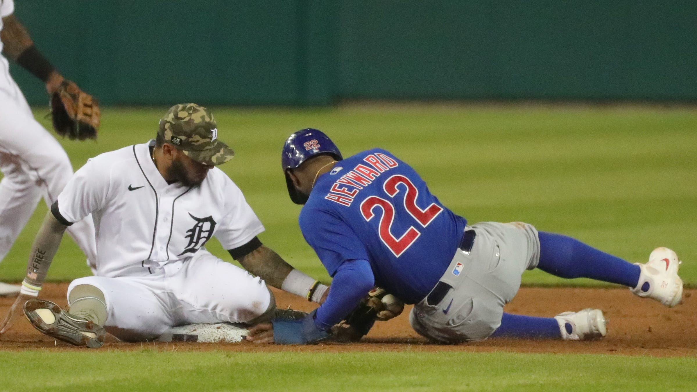 Tigers second baseman Harold Castro tags out Cubs right fielder Jason Heyward during the ninth inning of the Tigers' 4-2 loss on Friday, May 14, 2021, at Comerica Park.