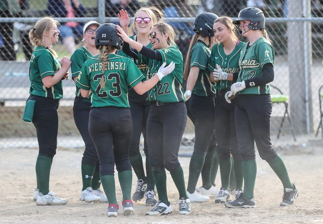 The Laconia High School softball team congratulates Morgan Wiercinski (23) for hitting a solo home run against Winneconne on Friday, May 14, 2021, in Rosendale, Wis. Laconia won the game 6-3.